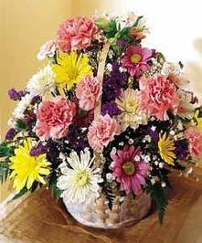 Basket of mixed cut spring flowers & filler