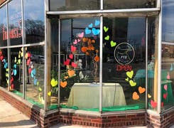 Colorful hand-made hearts decorate the front window of our Chicago storefront