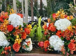 Twin orange, yellow and white arrangements, as seen at a Chicago corporate event